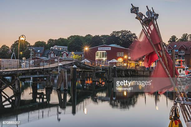 Germany, Schleswig-Holstein, Eckernfoerde, Harbour with wooden bridge and shipyard
