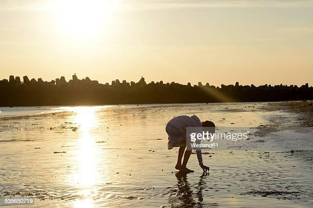 Germany, Schleswig-Holstein, Helgoland, Duene Island, girl on beach at low tide