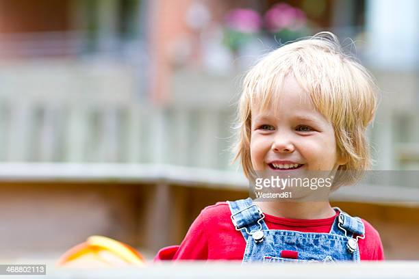 Germany, Schleswig-Holstein, Kiel, portrait of smiling little girl at playground