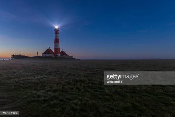 Germany, Schleswig-Holstein, North Sea Coast, View of Westerheversand Lighthouse at night