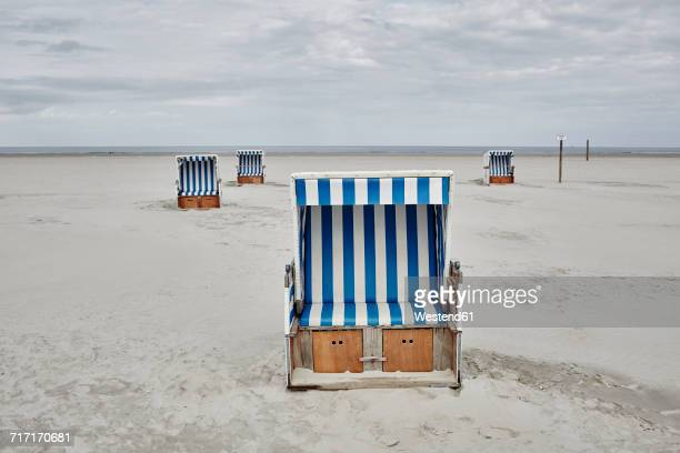 Germany, Schleswig-Holstein, St Peter-Ording, hooded beach chair