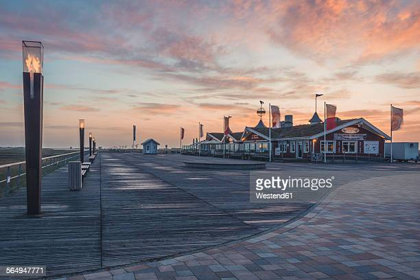 Germany, Schleswig-Holstein, St Peter-Ording, sunset at pier