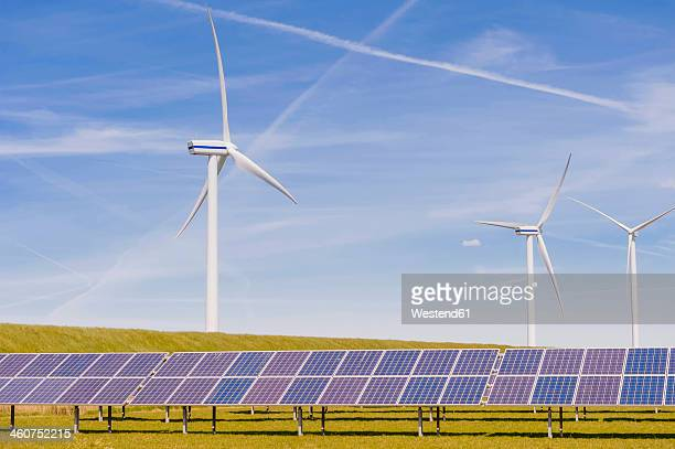 Germany, Schleswig-Holstein, View of solar panel and wind turbine in field