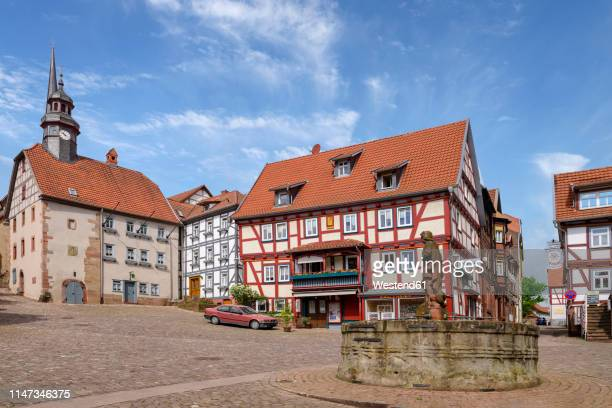 germany, schlitz, market square with townhall - rathaus stock-fotos und bilder