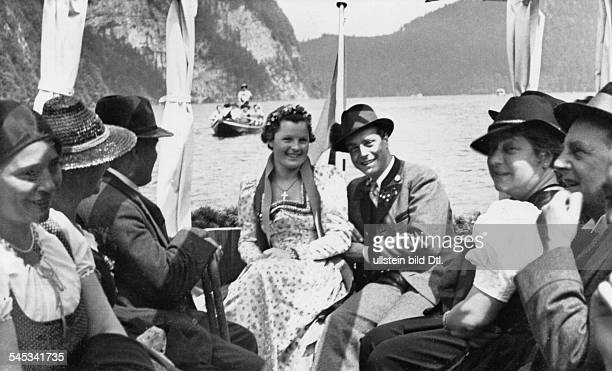 Germany Schneider, Magda - Actress, Germany - *-+ - in St. Bartolomae at Lake Koenigssee after her church wedding with Wolf Albach-Retty; right, next...