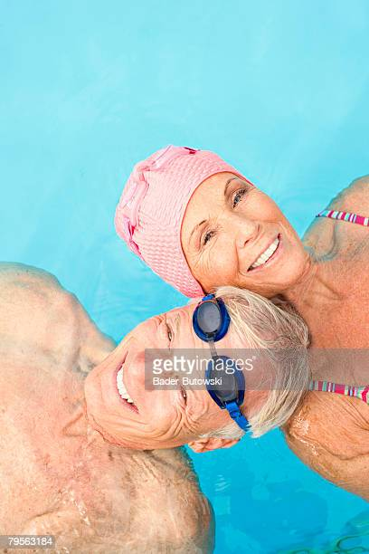 Germany, senior couple in swimming pool, elevated view, close-up