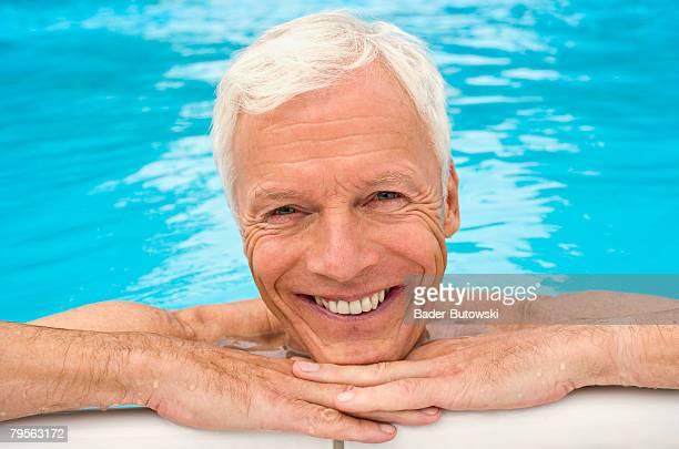 Germany, senior man in swimming pool, portrait, close-up