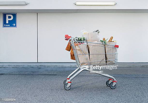 germany, shopping cart with groceries - shopping cart stock pictures, royalty-free photos & images