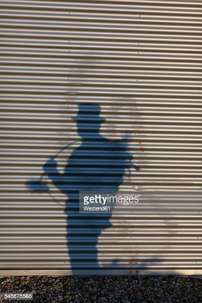 Germany, silhouette of chimney sweep on roller chutter