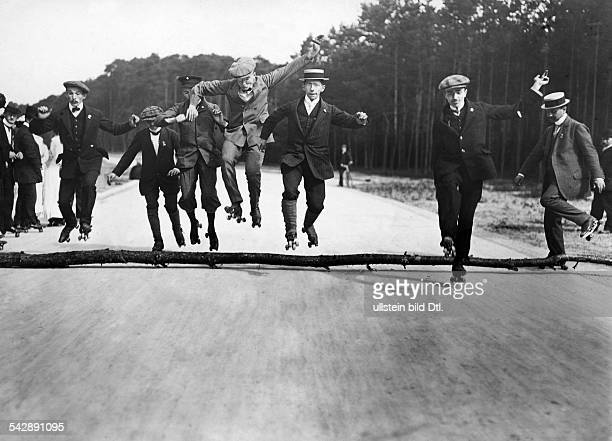 Germany: skating men jumping over a log, date unknown, around 1900