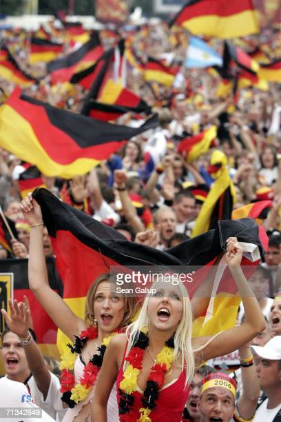 Germany soccer fans celebrate their victory in penalsty kicks against Argentina while watching the FIFA World Cup 2006 Quarter Finals match at the...