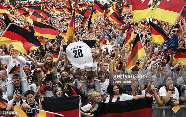 Germany soccer fans crowd the Fan Fest outdoor viewing area at the Brandenburg Gate while watching the FIFA World Cup 2006 Quarter Finals macth...