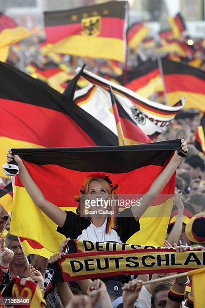 Germany soccer fans wave German national flags prior to watching the FIFA World Cup 2006 Semi Finals match between Germany and Italy at the Fan Fest...