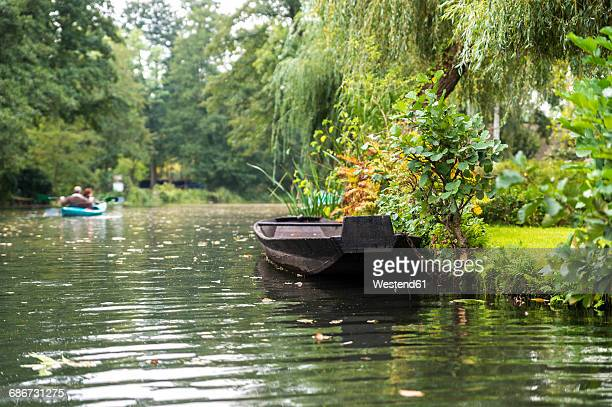 Germany, Spreewald, Luebbenau, boat at rivershore