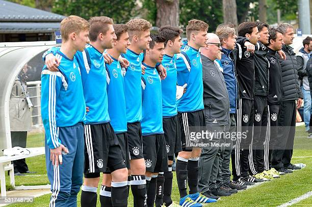 Germany staff and substitute players during the National Anthem before the U16 international friendly match between France and Germany on May 16 2016...