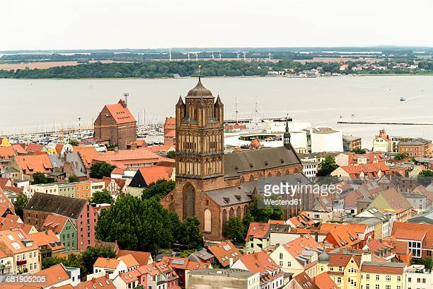 Germany, Stralsund, view to St. James Church at the historic old town and Ruegen Island