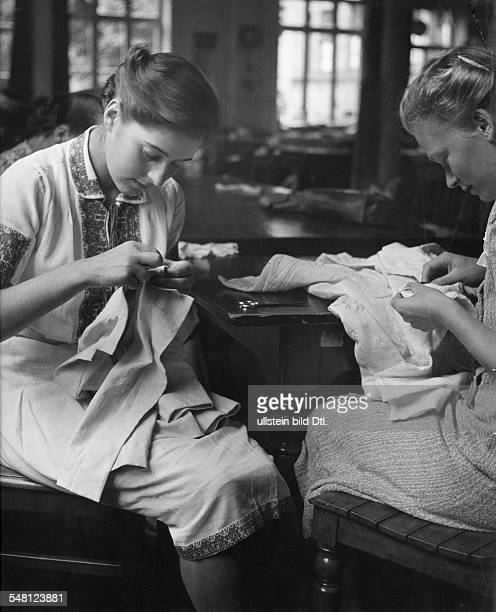Germany Students of the School of Arts and Crafts in Stuttgart working in a sewing school run by Nazi Germany's women's association August 1940...
