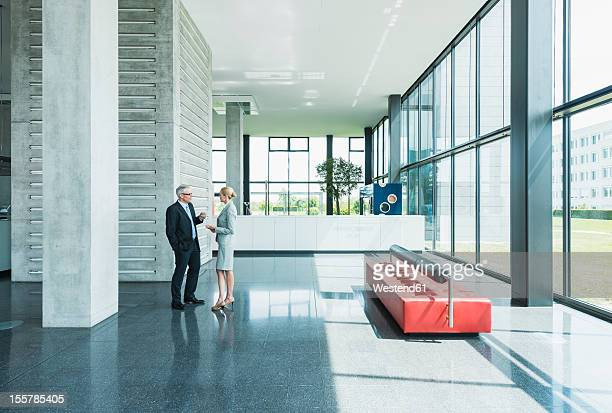 Germany, Stuttgart, Business people having discussion at office lobby