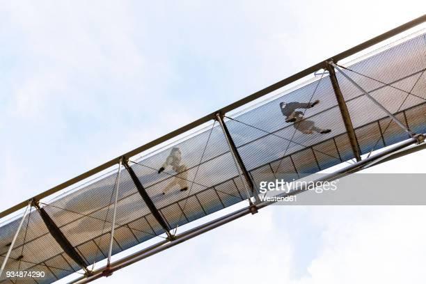 germany, stuttgart, free-floating pedestrian bridge - footbridge stock photos and pictures