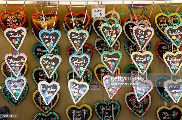Germany, Stuttgart, Heart shaped gingerbreads hanging in shop