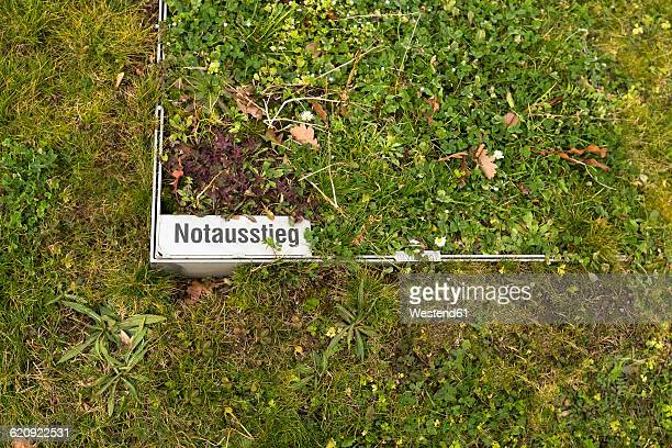 Germany, Stuttgart Vaihingen, escape hatch on a meadow of campus