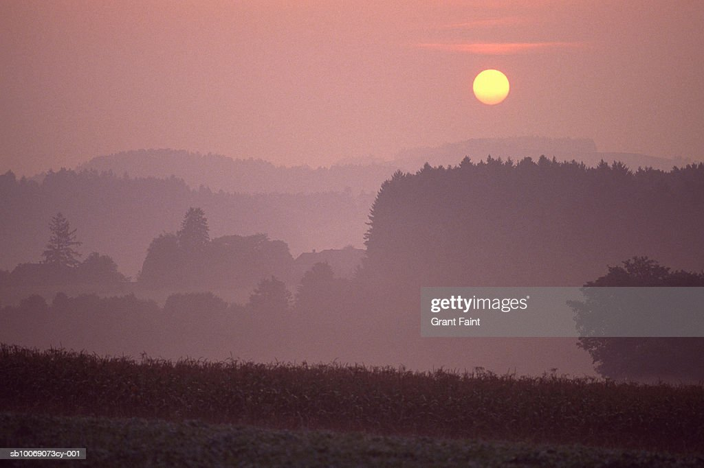 Germany, sunrise over farmland : Stockfoto