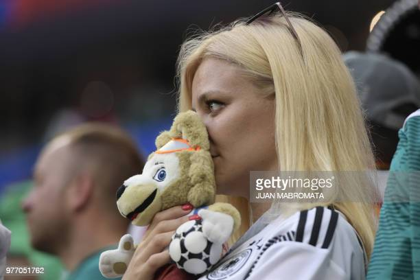 A Germany supporter reacts after Germany lost the Russia 2018 World Cup Group F football match between Germany and Mexico at the Luzhniki Stadium in...