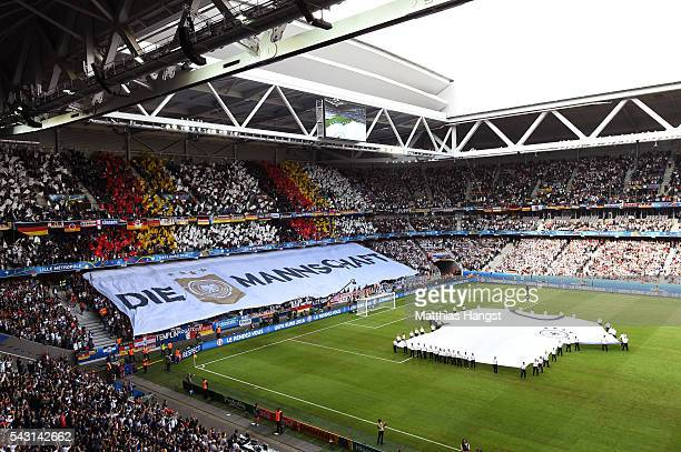 Germany supporters cheer prior to the UEFA EURO 2016 round of 16 match between Germany and Slovakia at Stade PierreMauroy on June 26 2016 in Lille...