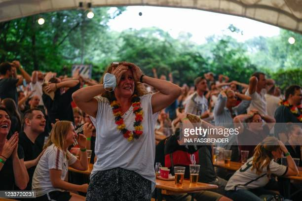 Germany supporters react after England scored during the UEFA EURO 2020 round of 16 football match between England and Germany at the Grugapark in...