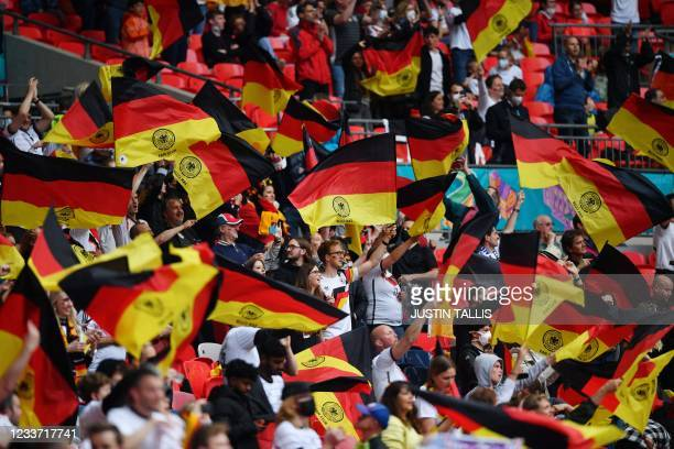 Germany supporters wave the national flag ahead of the UEFA EURO 2020 round of 16 football match between England and Germany at Wembley Stadium in...