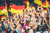 Germany supporters waving their flags on a stadium