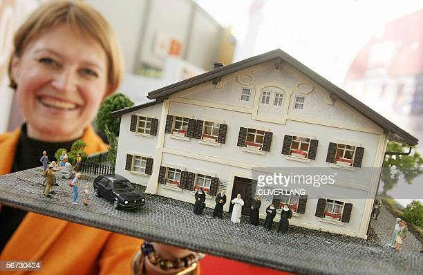 Susanne Tochtermann chairman of toy company Vollmer GmbH presents a miniature reconstruction of the house in which German Pope Benedict XVI was born...