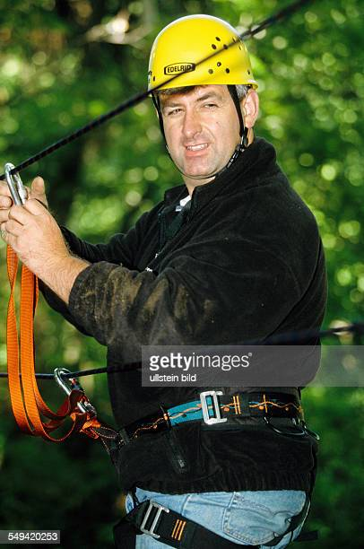 DEU Germany Swabian Alb Team Craft Manager Survival Training Manager of Carl Zeiss Daimler Chrysler Weigle furniture workshops crossing a ravine with...