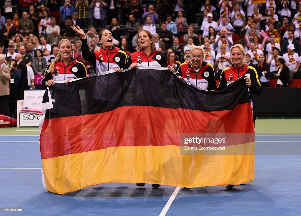 Germany team Angelique Kerber, Andrea Petkovic, Julia Goerges, Sabine Lisicki and captain Barbara Rittner celebrate after their victory in the Fed Cup 2015 World Group First Round tennis between Germany and Australia at Porsche-Arena on February 8, 2015 in Stuttgart, Germany.