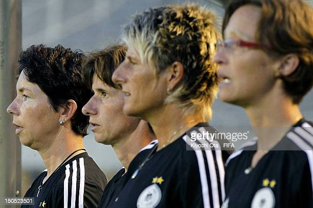 Germany team head coach Maren Meinert sings the national anthem prior to the FIFA U20 Women's World Cup Japan 2012 Group D match between Germany and...