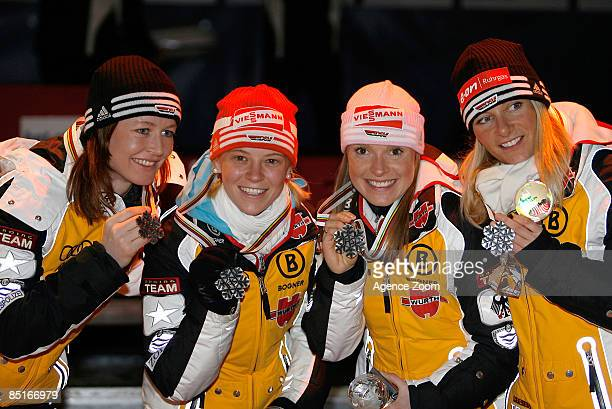 Germany team members Katrin Zeller Stehle Evi Sachenbacher Miriam Goessner and Claudia Nystad celebrate with their silver medals after the FIS Nordic...