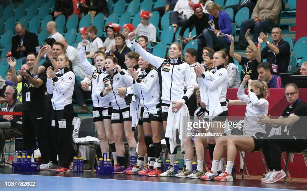 Germany team members on the bench celebrate during a handball match between Germany and the DR Congo at the IHF Women's Handball World Championship...