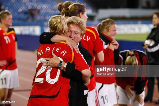 Germany teammates comfort each other after the FIFA U17 Women`s World Cup Semi Final match between Germany and the USA at QE II Stadium on November...