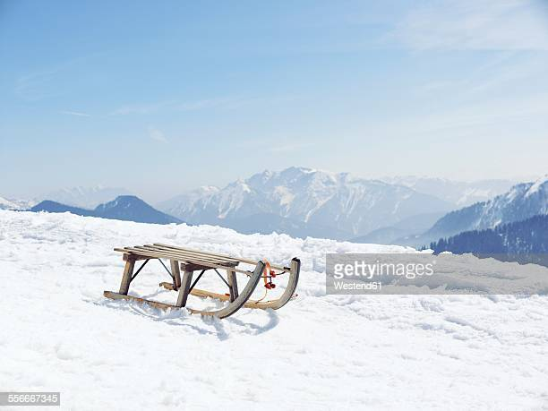 Germany, Tegernsee, sledge standing on Wallberg