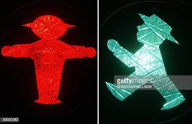 The combo of pictures taken on 06 June 2005 in Zwickau shows the red and green Ampelmaennchen sign of an east German traffic light for pedestrians...