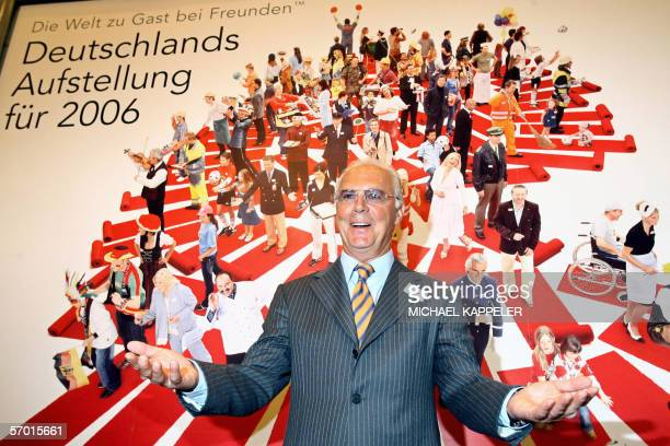 The president of the FIFA Football World Cup 2006 organizing committee Franz Beckenbauer poses in front of a poster by the German service and...