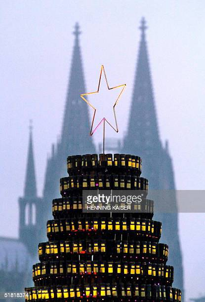 The top of a huge Christmas tree made of 2500 empty beer bottles built by German artists Ralph Juecker and Thomas Kraus on the banks of the river...