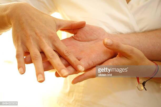 Germany: Therapy. A patient during the therapy for the hands.
