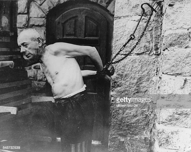 Germany Third Reich concentration camps 193945 A former inmate of Mauthausen concentration camp demonstrating a punitive measure by the guards after...