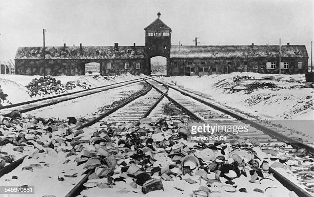Germany Third Reich concentration camps 193945 Auschwitz Concentration Camp The entrance after the liberation In front material left behind by the...