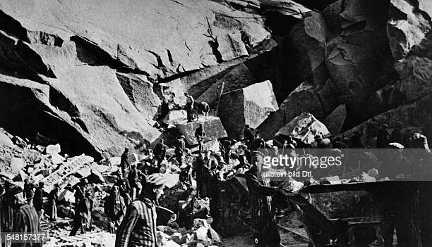 Germany Third Reich concentration camps 193945 Detainees of Flossenbuerg concentration camp at work in a quarry undated beginning of the 1940ies