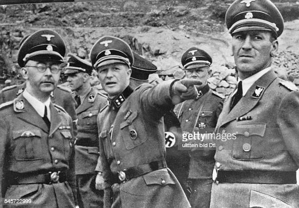 Germany Third Reich concentration camps 193945 Inspecting the concentration camp at Mauthausen From left Head of the SS Heinrich Himmler...