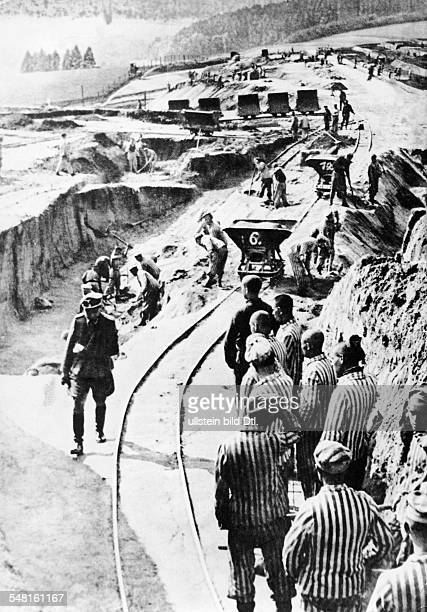 Germany Third Reich concentration camps 193945 Prisoners at Mauthausen concentration camp doing forced labor undated beginning of the 1940ies