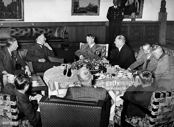 Germany Third Reich Negotiations during the Munich Conference 1938 from the left Joachim von Ribbentrop British Prime Minister Neville Chamberlain...