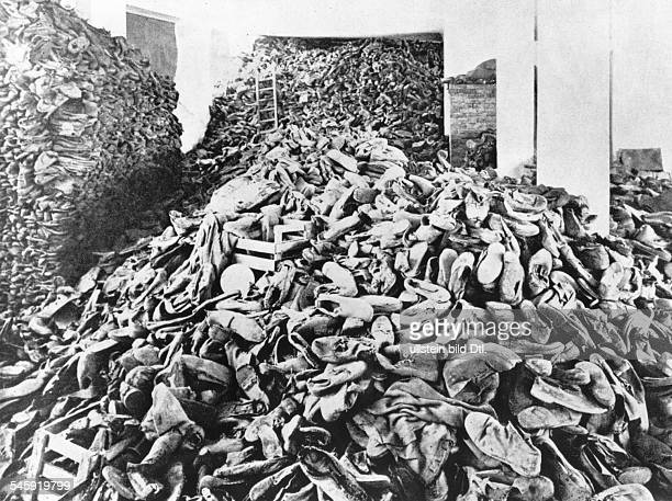 Germany Third Reich NS era Persecution of Jews Holocaust Probably Concentration Camp of Treblinka or Belzec Piled up shoes of murdered prisoners...